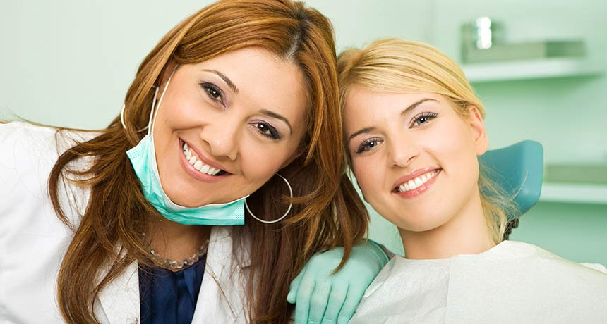Patient and dentist smiling together