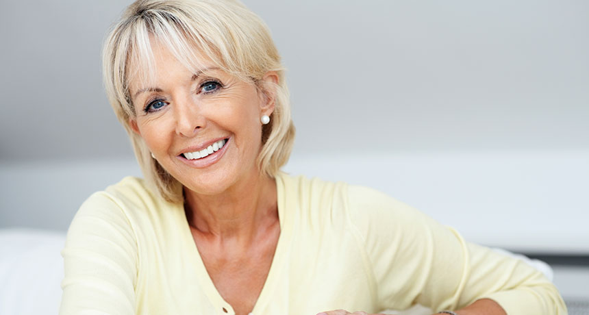 A woman with dentures smiling